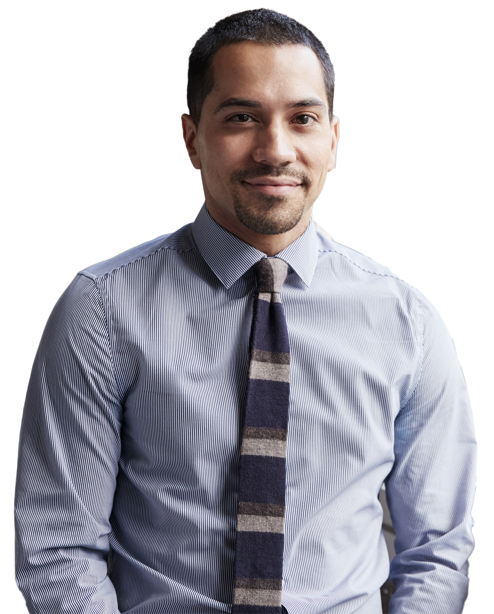 young-hispanic-business-man-smiling-to-camera-PGJV4CK